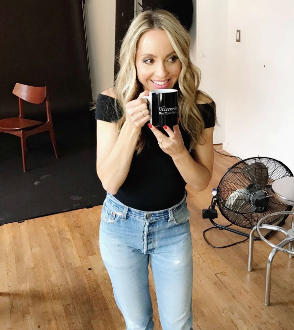 Gabby bernstein holding a universe has your back mug, manifesting