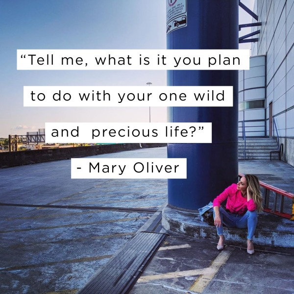 Gabby sitting in an open space with Mary Oliver quote