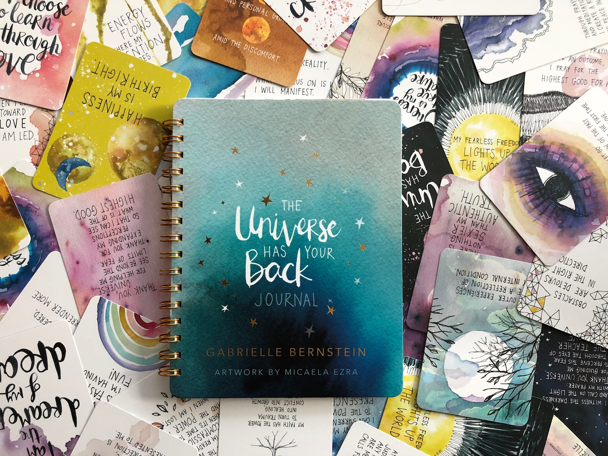 The Universe Has Your Back Journal surrounded by cards from The Universe Has Your Back card deck | Gabby Bernstein