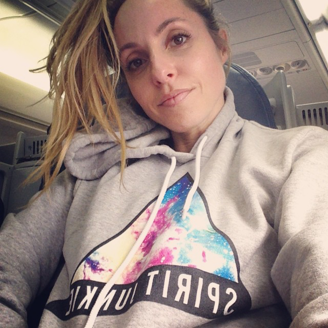 Gabby Bernstein on a plane for her book tour   Travel hacks