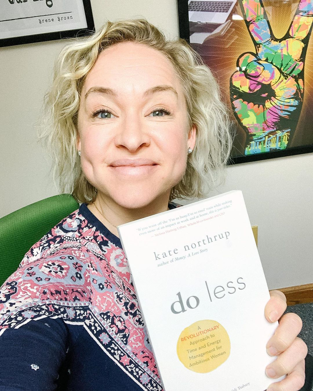 Kate Northrup holding her book Do Less