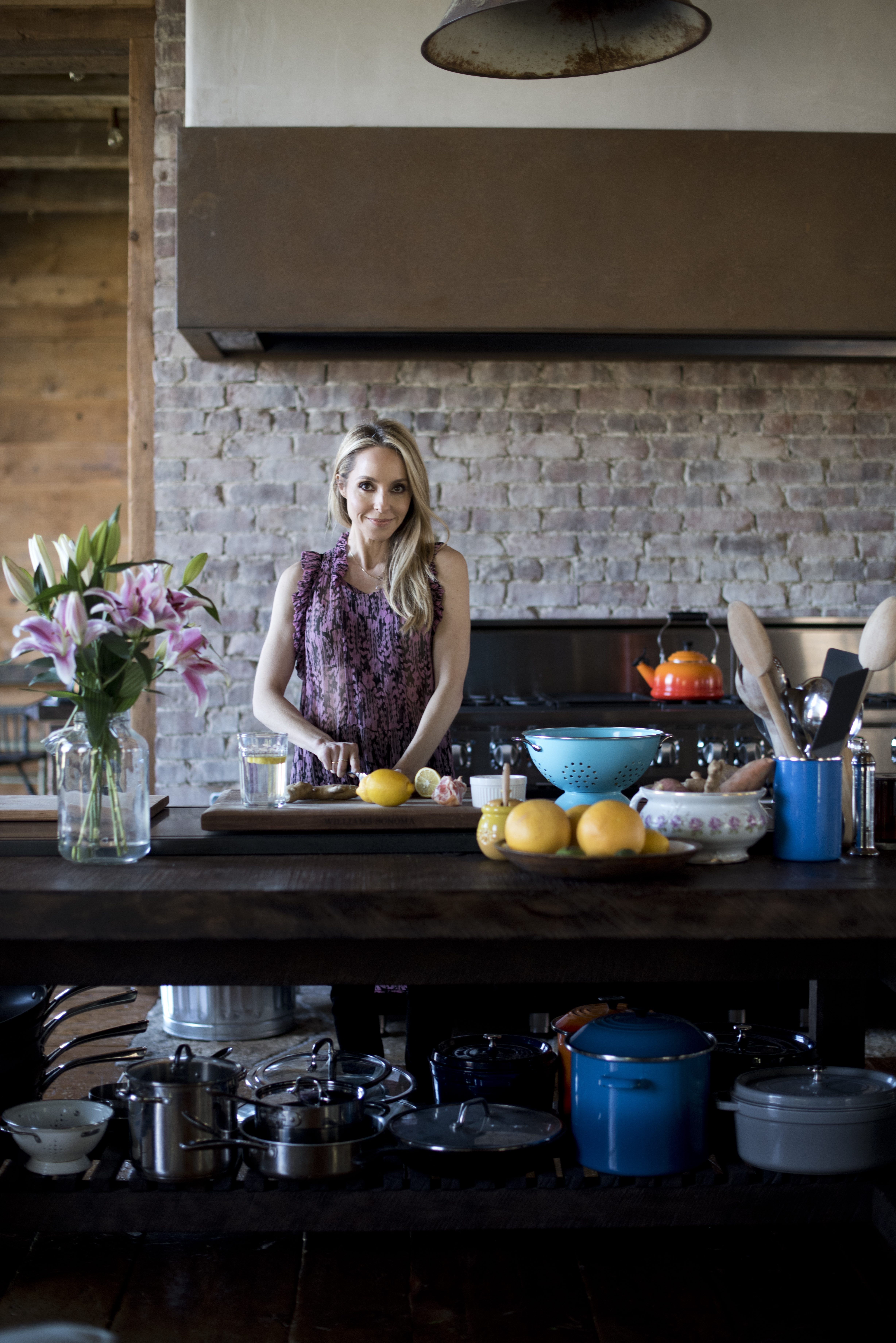 gabby bernstein slicing lemons in her kitchen | gut health