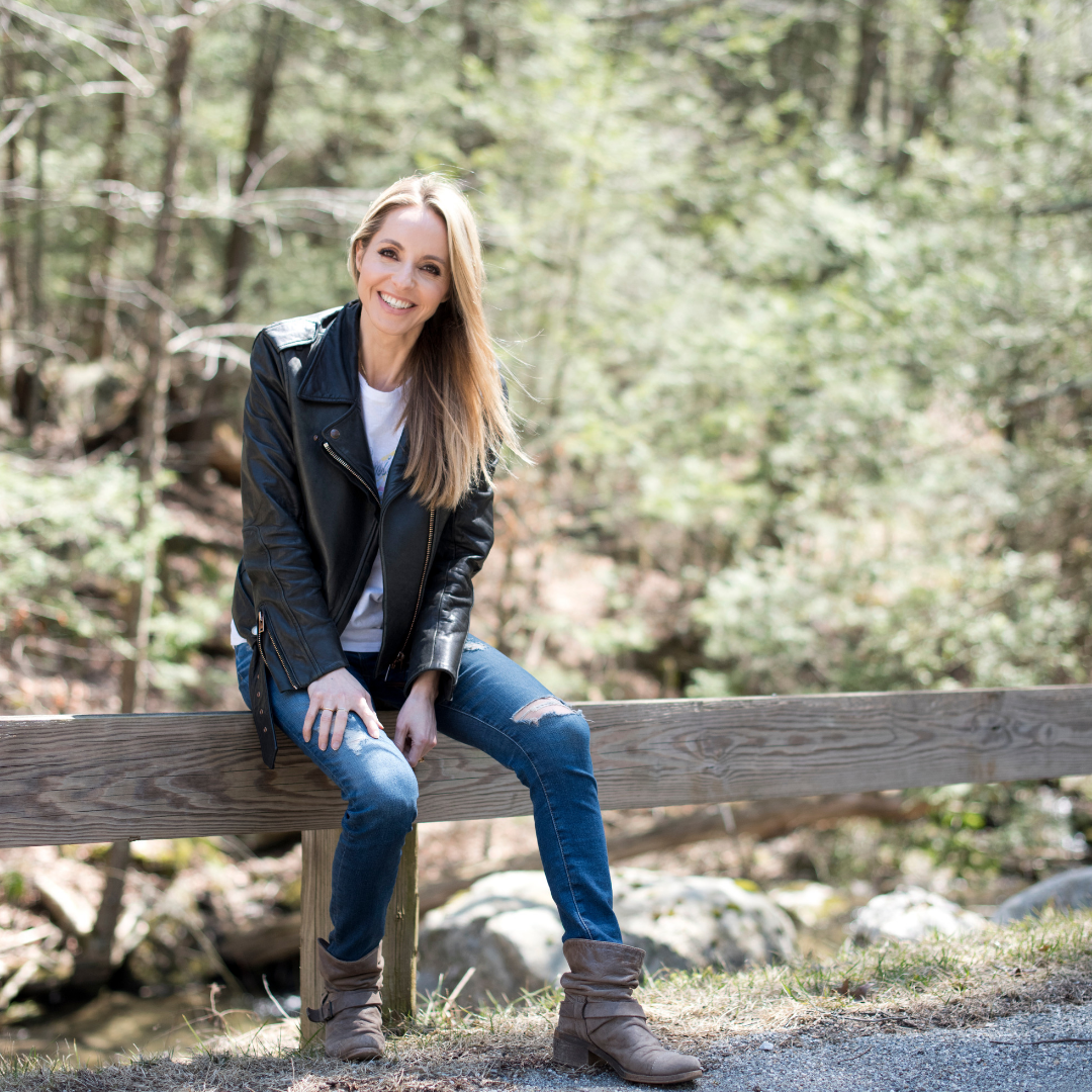 Gabby Bernstein happy in the woods in springtime | Honor your feelings