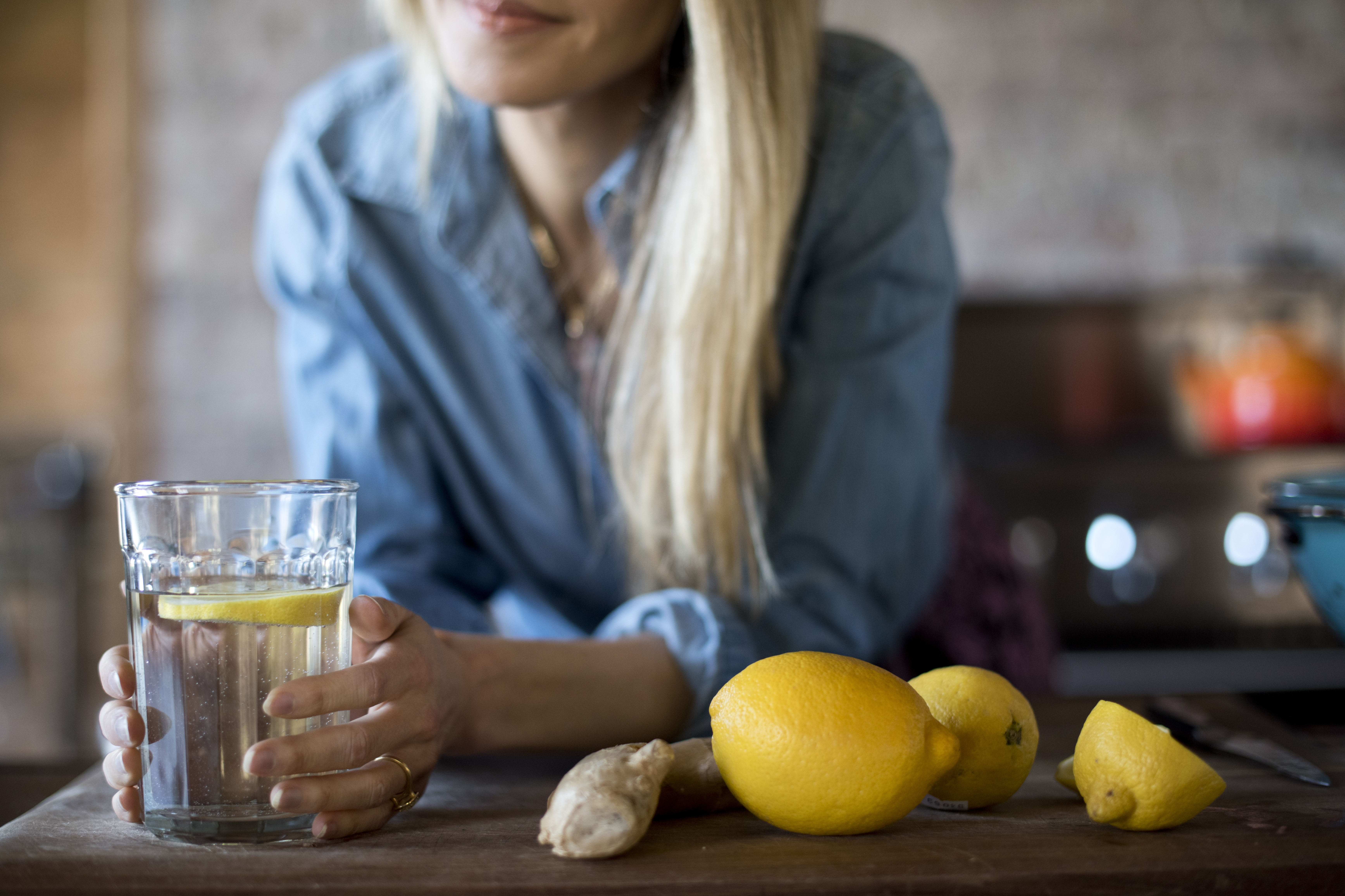 gabby bernstein with a glass of lemon water | gut health